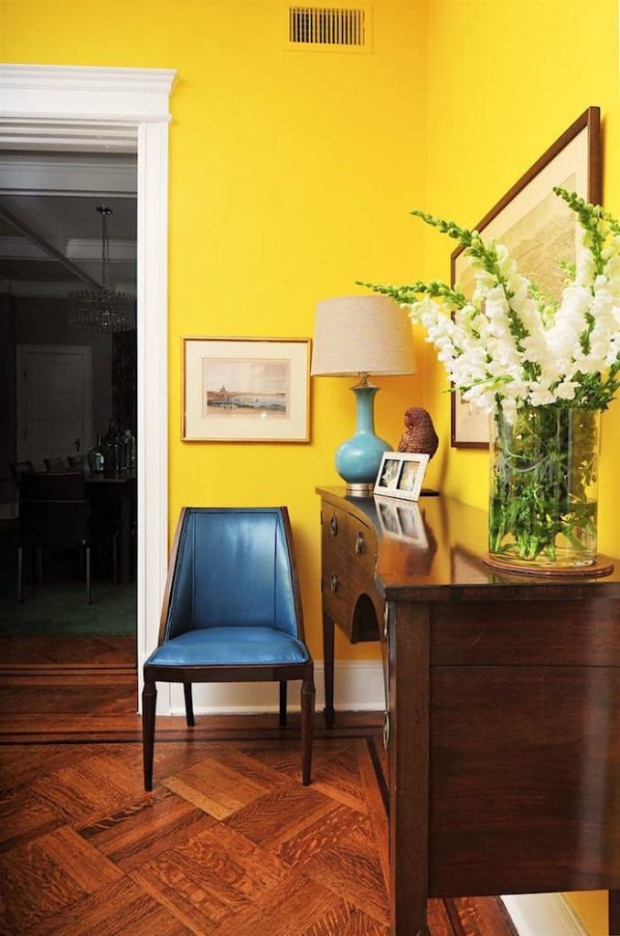 Modern room with bright yellow walls