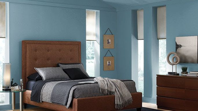 Cozy bedroom painted in Behr Blueprint