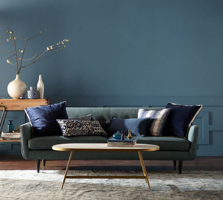 Monochromatic living room with couch painted Behr Blueprint