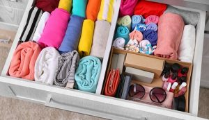 A colorful drawer organized with KonMari folding technique.
