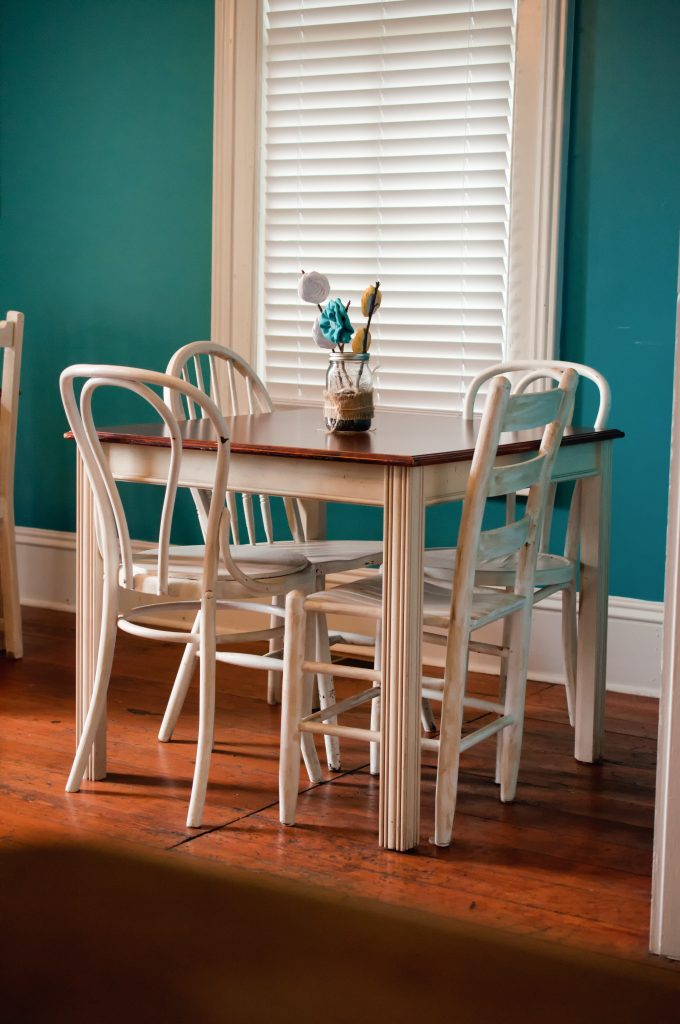 Bright blue/green wall in dining room.