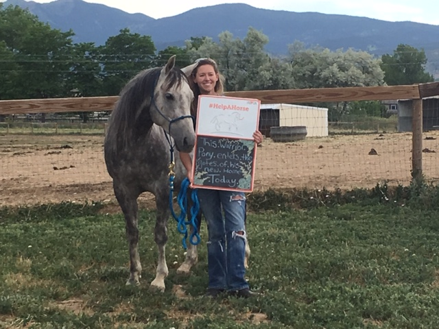 Picture of Odin and his new mom holding a CHR sign - Odin's adoption