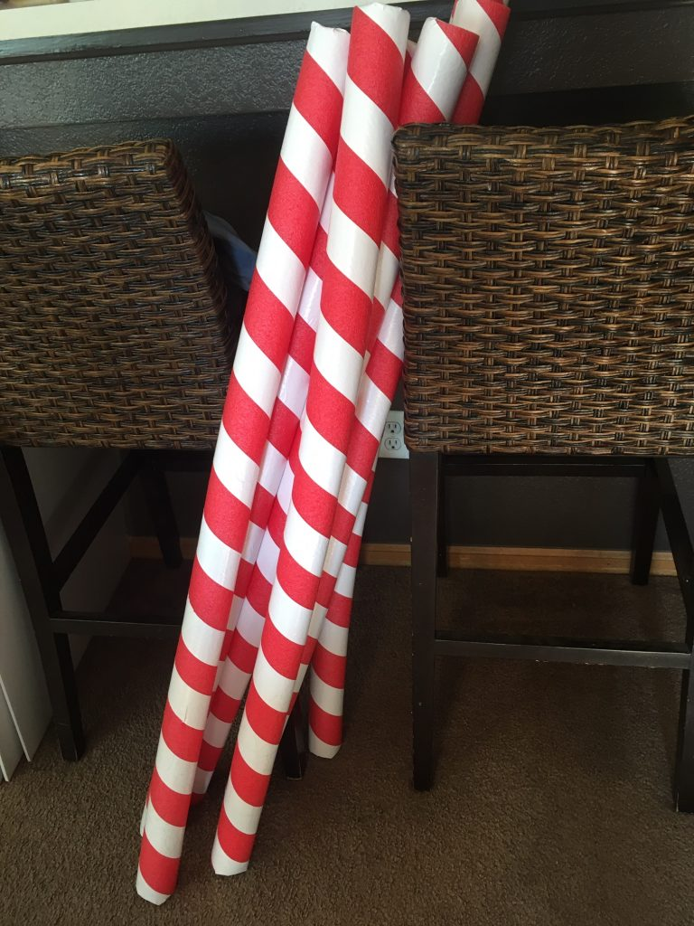 Photo of pool noodles made into candy cane window trim
