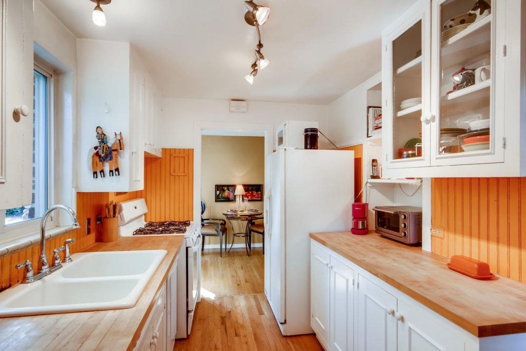 The farmhouse style kitchen with butcher block counters in the house