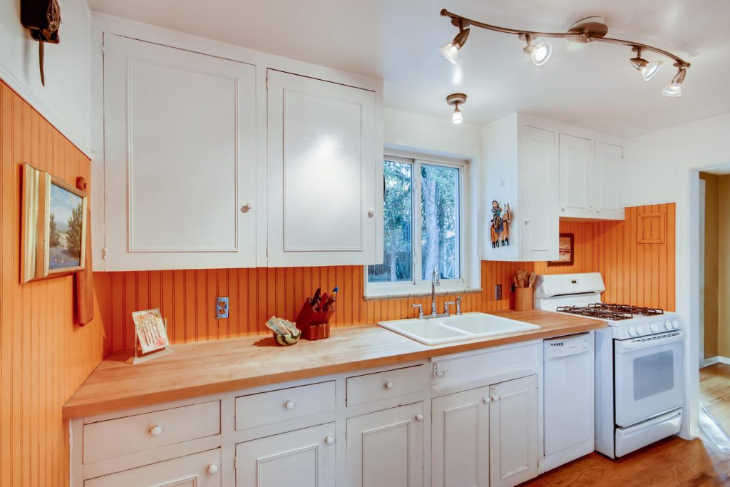 The farmhouse style kitchen with butcher block counters in the Mayfair house