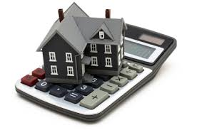 Picture of toy house sitting on top of a calculator for refinancing post