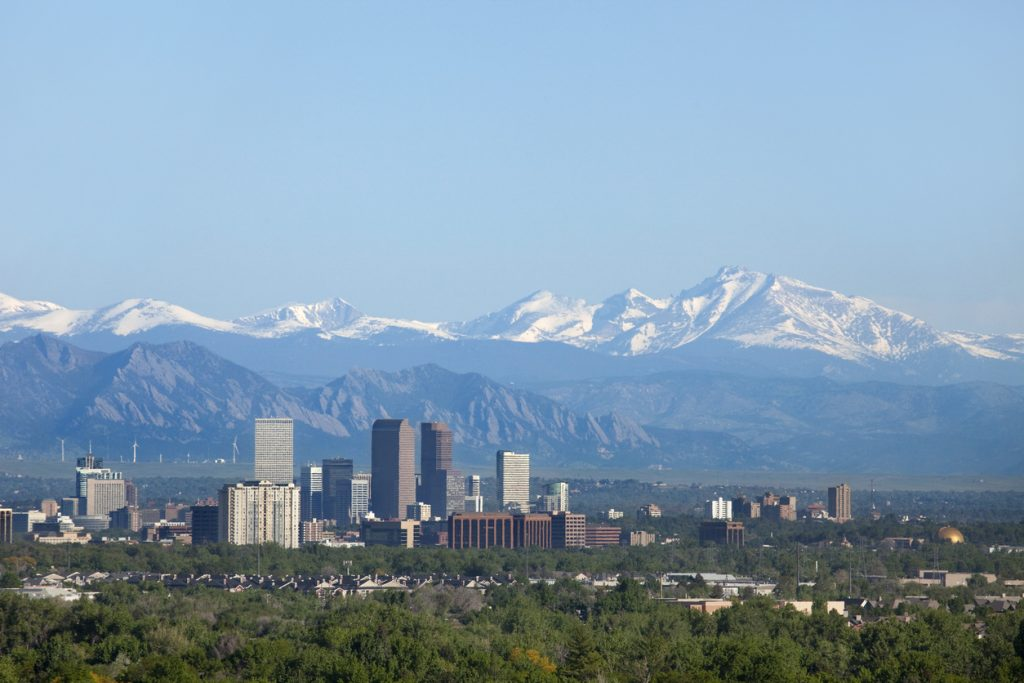 Denver Colorado skyline with view of downtown and the Rocky Mountains blue sky day