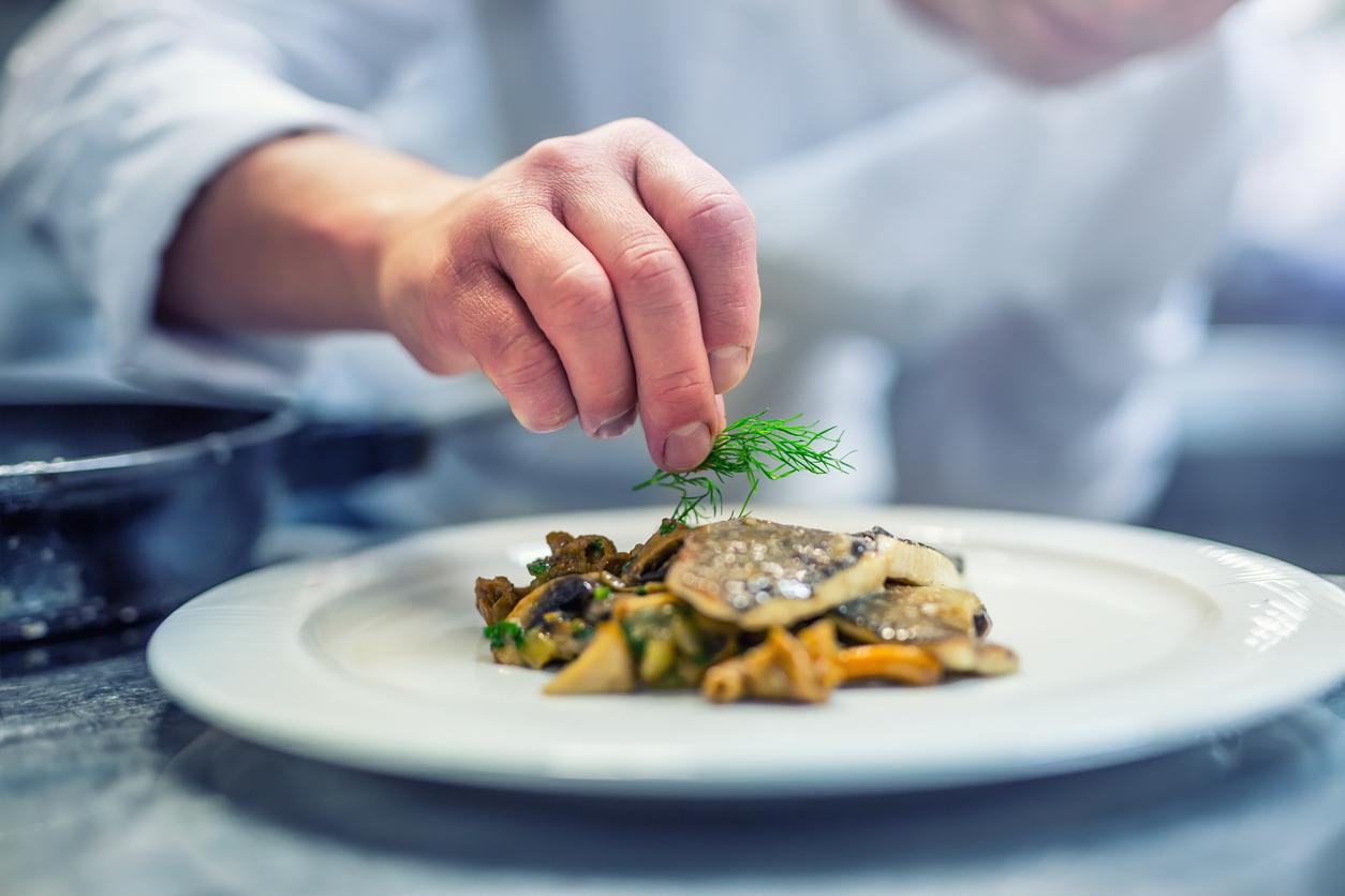 chef garnishing dish