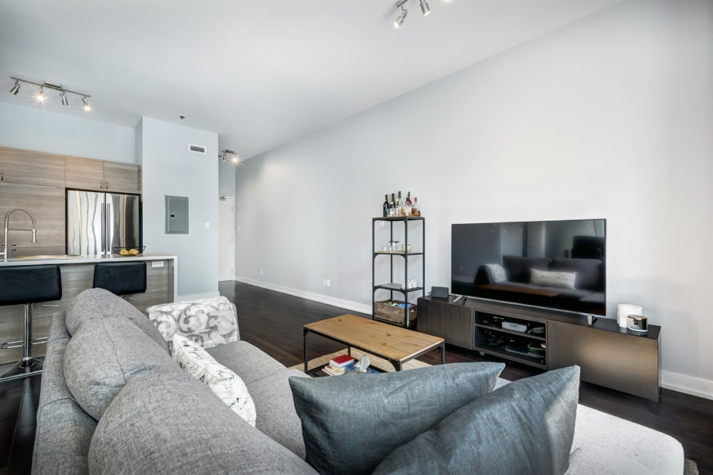 condo staged with owner's furniture to look professional