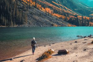 Woman hiking in the Snowmass Wilderness Area as one of fun fall activities