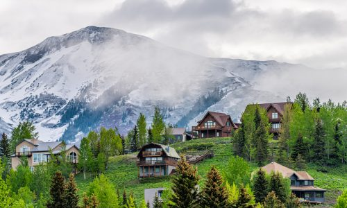 picture of Colorado real estate, houses situated on a hill with a mountain behind
