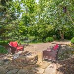 Private back yard with paver patio and multiple entertaining areas